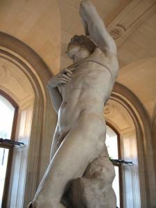 Miguel Ángel, el llamado Esclavo moribundo (c. 1513) Museo del Louvre: la cara  del simio puede adivinarse en la roca bajo las piernas del Esclavo.
