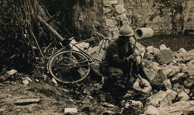 Soldier Reading a Letter Among Rubble